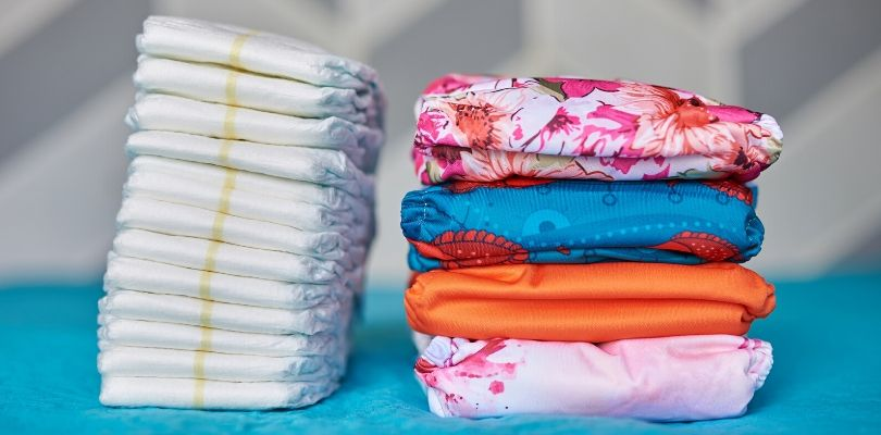 A picture of cloth and disposable diapers.
