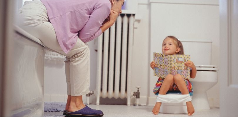 A toddler being potty trained.
