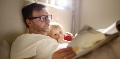 A father reading to his child before bed.