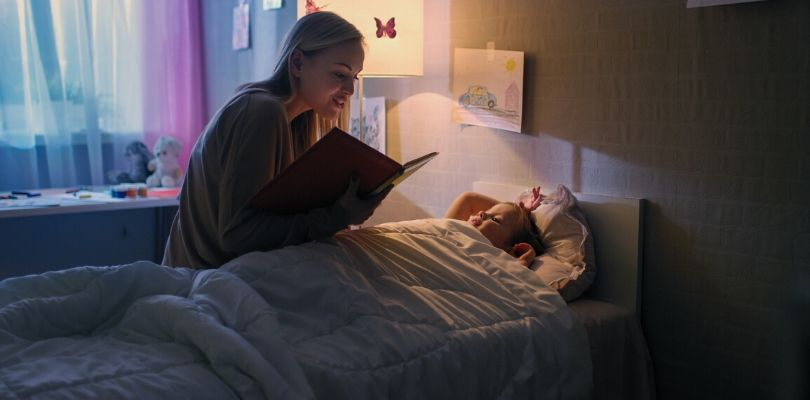 a mother reading her child a bedtime story