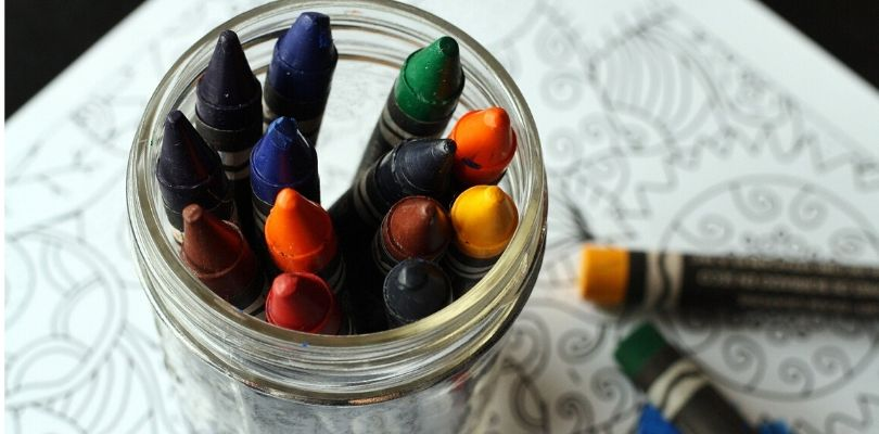 Crayons on an art table.