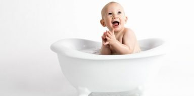 A baby in a bathtub.