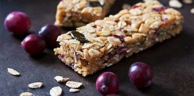 A protein bar with cranberries.