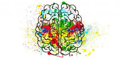 An illustration of a brain with color splotches.